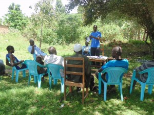 The Water Project : kenya4264-19-seasona-calender-discussion-at-lutaso-market