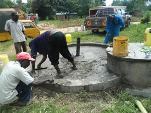 The Water Project : kenya4264-24-lutaso-market-pad-construction