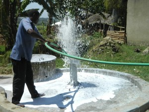 The Water Project : kenya4264-25-flushing-the-well