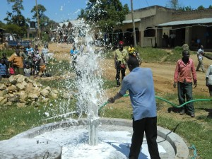 The Water Project : kenya4264-26-flushing-the-well