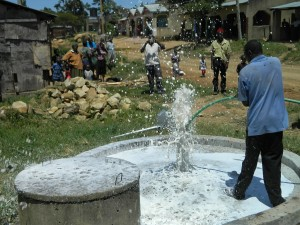 The Water Project : kenya4264-28-flushing-the-well