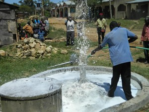The Water Project : kenya4264-29-flushing-the-well