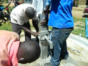 The Water Project : kenya4264-38-tightening-nuts