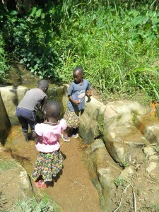 The Water Project : kenya4281-01-imulama-community-children-fetching-water-from-a-spring