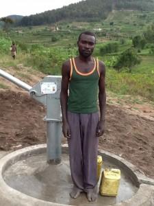 The Water Project : rwanda3083-06-caretaker
