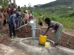 The Water Project : rwanda3083-08-clean-water-flowing