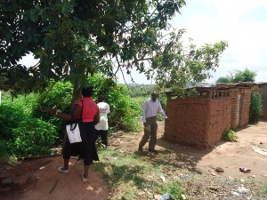 The Water Project : uganda6058-17-community-sanitation-inspection