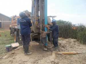 The Water Project : uganda6060-26-molly-intergrated-lowering-pvc-casing