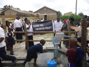 The Water Project : uganda6060-38-person-using-water