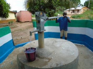 The Water Project : sierraleone5058-06-some-one-pumping-clean-water