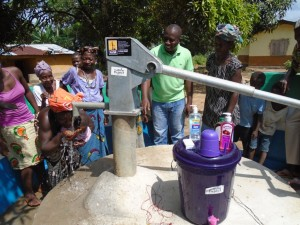 The Water Project : sierraleone5058-07-some-body-drinking-water