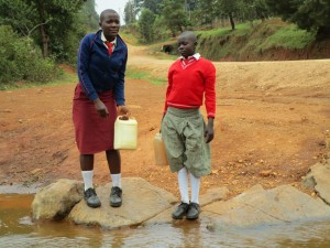 The Water Project : kenya4333-14-shisango-girls-fetching-water-from-their-current-water-source