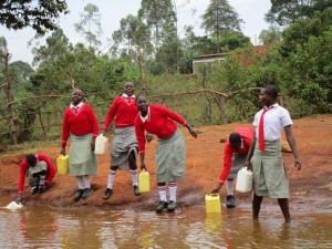 The Water Project : kenya4333-15-shisango-girls-fetching-water-from-their-current-water-source