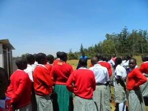 The Water Project : kenya4333-23-paul-and-the-students-on-environmental-walk-at-the-student-latrine