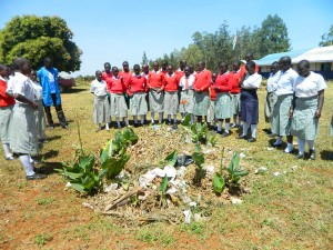The Water Project : kenya4333-25-paul-with-shisango-girls-secondary-students-on-environmental-walk-in-school-compound