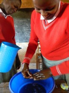 The Water Project : kenya4333-28-student-demonstrating-handwashing-process