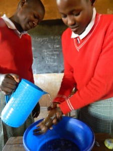 The Water Project : kenya4333-29-student-demonstrating-handwashing-process