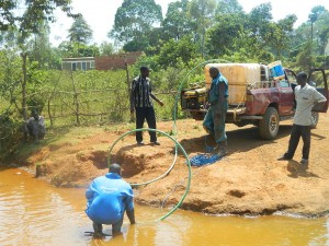 The Water Project : kenya4333-35-fetching-water-from-a-river-2km-away-to-be-used-for-drilling