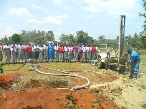 The Water Project : kenya4333-36-shisango-girls-witnessing-the-drilling-process