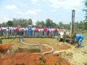 The Water Project : kenya4333-37-shisango-girls-witnessing-the-drilling-process