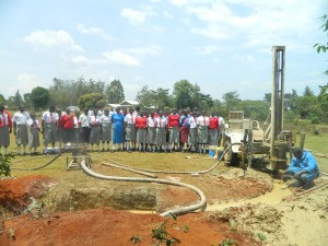 The Water Project : kenya4333-38-shisango-girls-witnessing-the-drilling-process