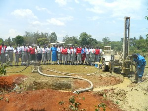 The Water Project : kenya4333-39-shisango-girls-witnessing-the-drilling-process
