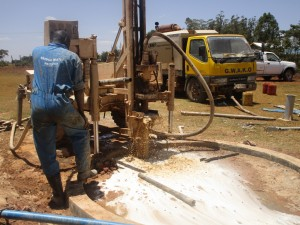 The Water Project : kenya4333-55-flushing-of-shisango-well
