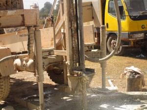 The Water Project : kenya4333-59-flushing-of-shisango-well