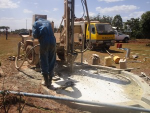 The Water Project : kenya4333-61-flushing-of-shisango-well