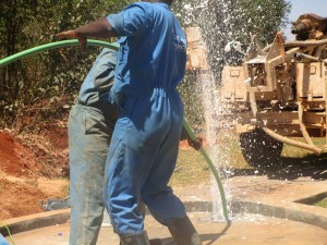 The Water Project : kenya4333-66-flushing-of-shisango-well