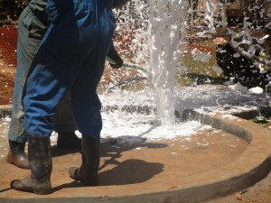 The Water Project : kenya4333-67-flushing-of-shisango-well