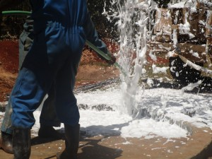 The Water Project : kenya4333-68-flushing-of-shisango-well