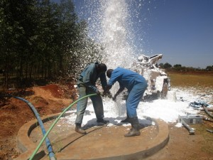 The Water Project : kenya4333-70-flushing-of-shisango-well