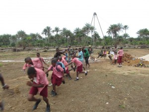 The Water Project : sierraleone5070-34-manual-yield-testing-students-helping