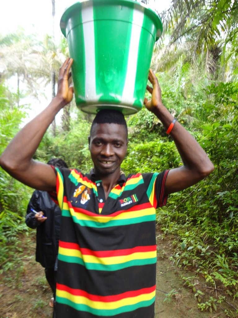 The Water Project : sierra-leone5074-05-carrying-water-back