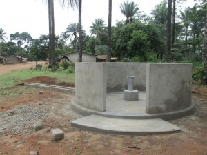 The Water Project : sierraleone5071-65-wall-construction-and-pump-installation