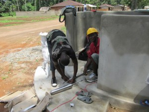 The Water Project : sierraleone5071-68-wall-construction-and-pump-installation