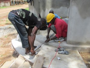 The Water Project : sierraleone5071-69-wall-construction-and-pump-installation