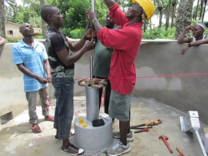 The Water Project : sierraleone5071-71-wall-construction-and-pump-installation