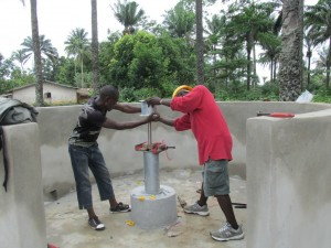 The Water Project : sierraleone5071-73-wall-construction-and-pump-installation