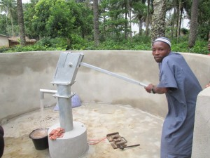 The Water Project : sierraleone5071-75-wall-construction-and-pump-installation
