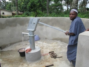 The Water Project : sierraleone5071-76-wall-construction-and-pump-installation
