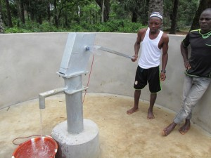 The Water Project : sierraleone5071-77-wall-construction-and-pump-installation
