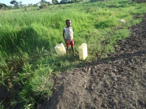 The Water Project : uganda683-02-jeeja-fetching-water