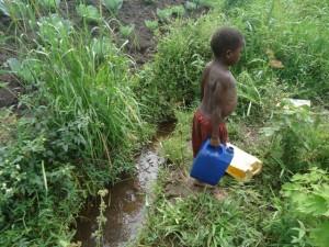 The Water Project : uganda684-03-waiga-fetching-water