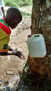 The Water Project : sierraleone5065-112-hygiene-training-tippy-tap-demonstration