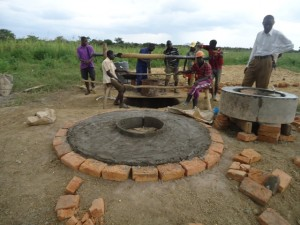 The Water Project : uganda687-09-constructing-the-well-pad