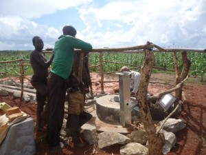 The Water Project : uganda6061-13-pump-installation