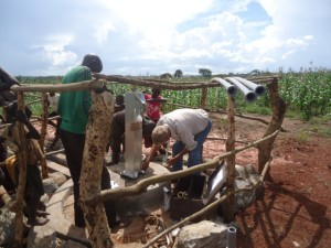 The Water Project : uganda6061-15-pump-installation