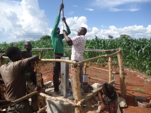 The Water Project : uganda6061-17-pump-installation